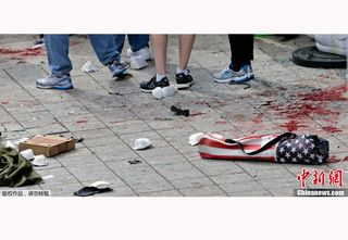 Boston-marathon-attack-blood-street-flag
